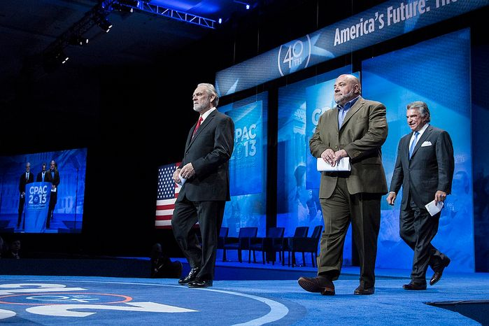 Larry Beasley, from left, president and CEO of The Washington Times, Tony Fabrizio, of the Fabrizio-McLaughlin polling firm, and Al Cardenas, chairman of the American Conservative Union, take the stage to announce the results of the Washington Times/CPAC 2013 straw poll during the final day of the 2013 Conservative Political Action Conference in Fort Washington, Md. on March 16, 2013. Sen. Rand Paul (R-KY) was the winner, narrowly edging out the close second place Sen. Marco Rubio (R-FL). (T.J. Kirkpatrick/Special to The Washington Times)
