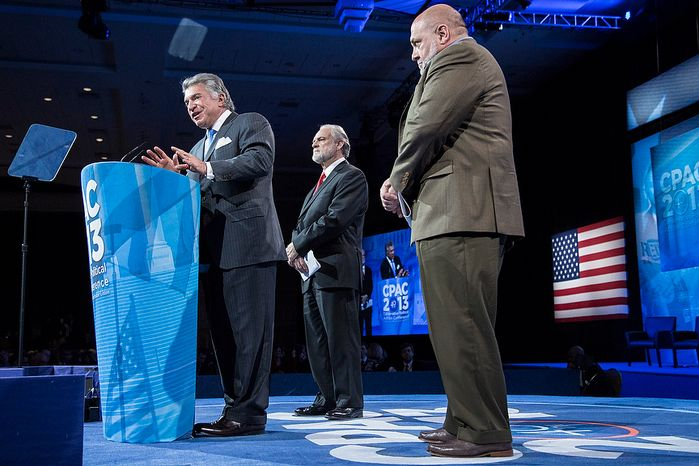 Al Cardenas, from left, chairman of the American Conservative Union, with Larry Beasley, president and CEO of The Washington Times, and Tony Fabrizio, of the Fabrizio-McLaughlin polling firm, speaks before announcing the results of the Washington Times/CPAC 2013 straw poll with and during the final day of the 2013 Conservative Political Action Conference in Fort Washington, Md. on March 16, 2013. Sen. Rand Paul (R-KY) was the winner, narrowly edging out the close second place Sen. Marco Rubio (R-FL). (T.J. Kirkpatrick/Special to The Washington Times)