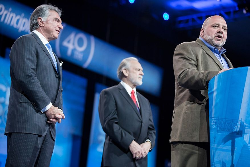 Tony Fabrizio, from right, of the Fabrizio-McLaughlin polling firm, announces the results of the Washington Times/CPAC 2013 straw poll with Larry Beasley, president and CEO of The Washington Times, and Al Cardenas, chairman of the American Conservative Union, during the final day of the 2013 Conservative Political Action Conference in Fort Washington, Md. on March 16, 2013. Sen. Rand Paul (R-KY) was the winner, narrowly edging out the close second place Sen. Marco Rubio (R-FL). (T.J. Kirkpatrick/Special to The Washington Times)