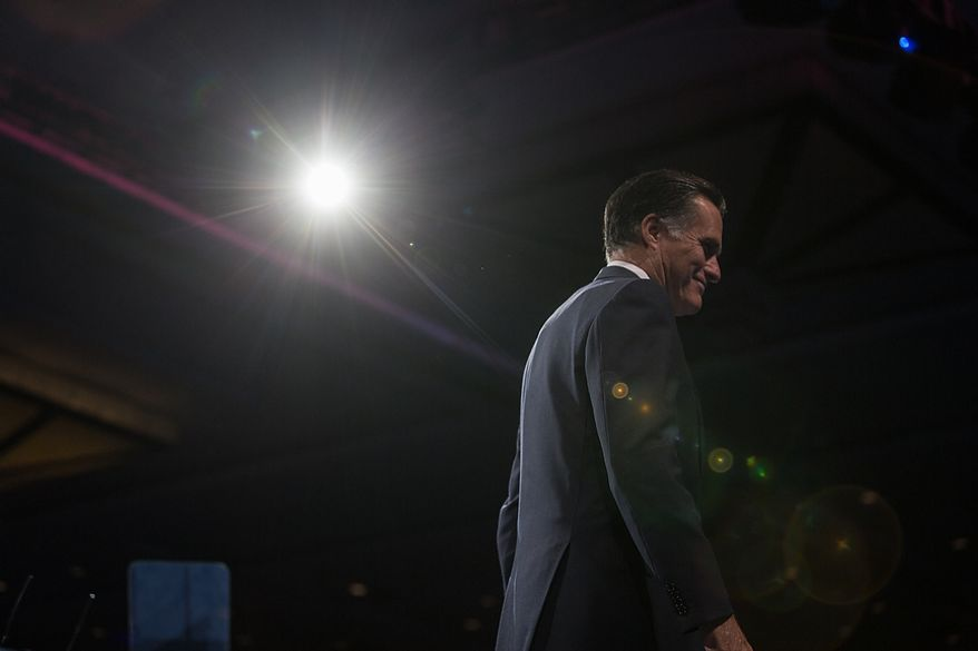 ** FILE ** Mitt Romney leaves the stage after he speaks at this year's Conservative Political Action Conference (C.P.A.C.) held at the Gaylord National Hotel, National Harbor, Md., Friday, March 15, 2013. (Andrew S. Geraci/The Washington Times)