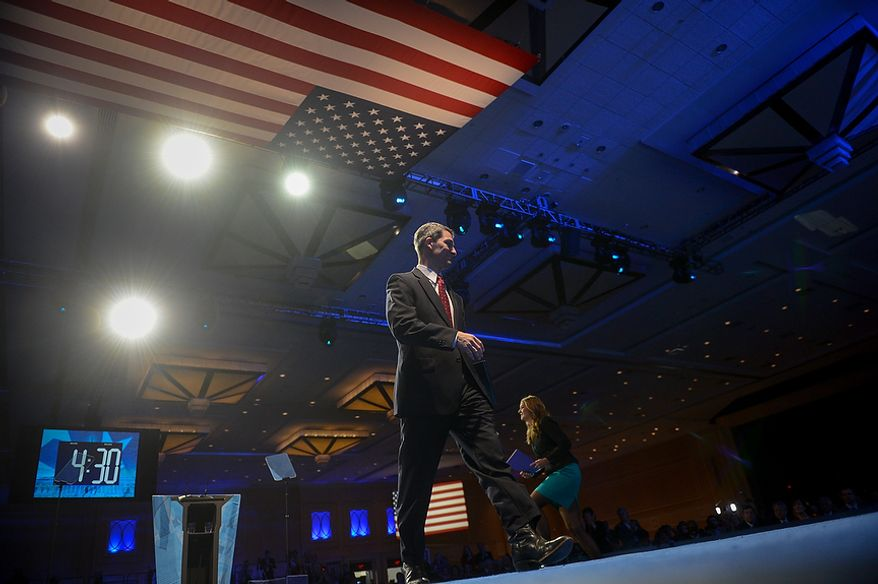 Virginia Attorney General Ken Cuccinelli leaves the stage after being the first speaker at this year's Conservative Political Action Conference (C.P.A.C.) held at the Gaylord National Hotel, National Harbor, Md., Thursday, March 14, 2013. (Andrew Harnik/The Washington Times)