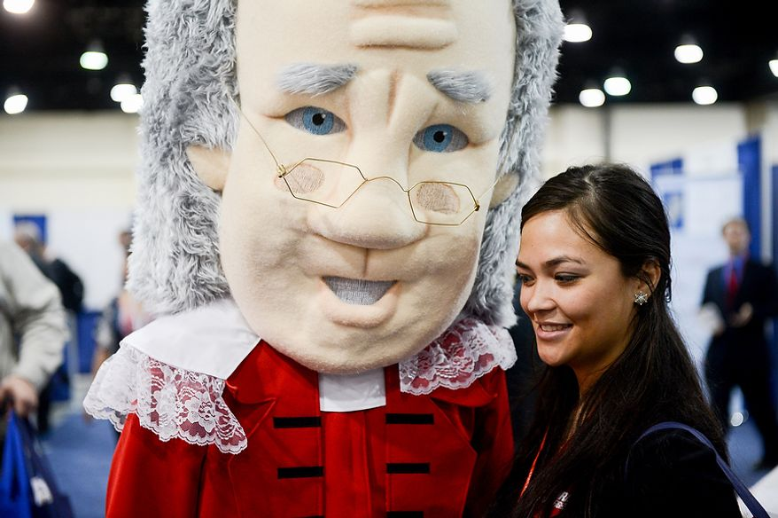Janine Jakubkas [cq] of New York, N.Y. poses with a man dressed as Benjamin Franklin at this year's Conservative Political Action Conference (C.P.A.C.) held at the Gaylord National Hotel, National Harbor, Md., Thursday, March 14, 2013. (Andrew Harnik/The Washington Times)