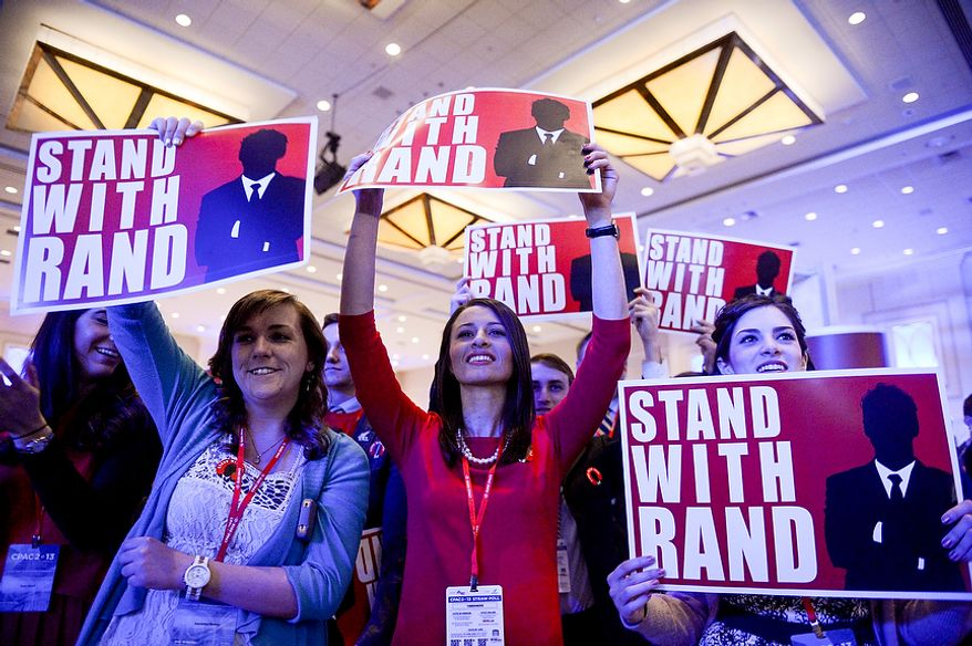Supporters listen as Sen. Rand Paul (R-K.Y.) speaks at this year's Conservative Political Action Conference (C.P.A.C.) held at the Gaylord National Hotel, National Harbor, Md., Thursday, March 14, 2013. (Andrew Harnik/The Washington Times)