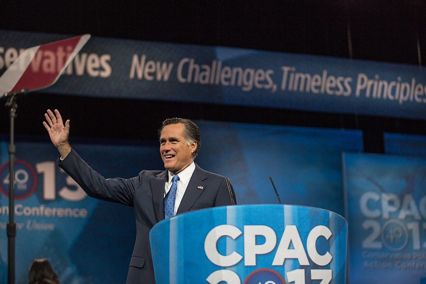 Mitt Romney (R) waves to the audience before he speaks at this year's Conservative Political Action Conference (C.P.A.C.) held at the Gaylord National Hotel, National Harbor, Md., Friday, March 15, 2013.(Andrew S. Geraci/The Washington Times)