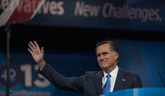 ** FILE ** Mitt Romney (R) waves to the audience before he speaks at this year's Conservative Political Action Conference held at the Gaylord National Hotel, National Harbor, Md., Friday, March 15, 2013. (Andrew S. Geraci/The Washington Times)