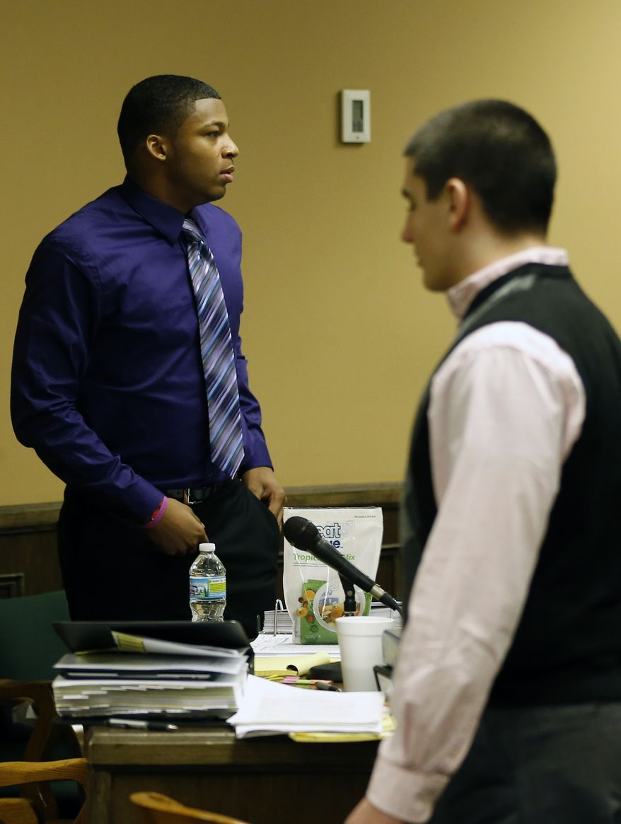 ** FILE ** Ma'lik Richmond (left), 16, and co-defendant Trent Mays, 17, walk around in the courtroom during a break on the fourth day of their trial on rape charges in juvenile court on Saturday, March 16, 2013, in Steubenville, Ohio. (AP Photo/Keith Srakocic, Pool)