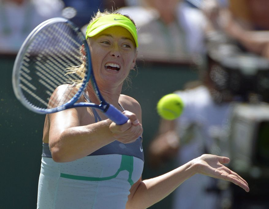 Maria Sharapova, of Russia, makes a return against Caroline Wozniacki, of Denmark, during their match at the BNP Paribas Open tennis tournament on Sunday, March 17, 2013, in Indian Wells, Calif. (AP Photo/Mark J. Terrill)