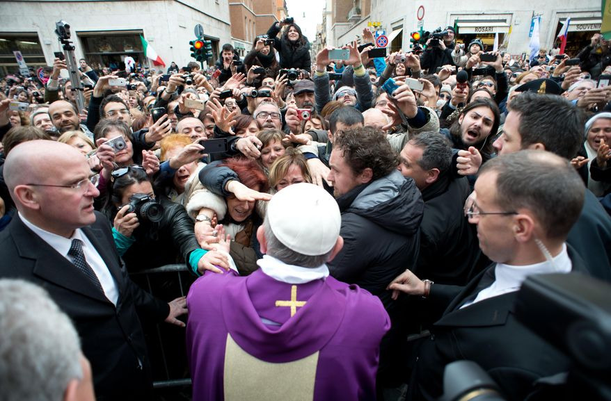 Pope Francis greets the faithful from a side gate of the Vatican on Sunday, March 17, 2013. (AP Photo/L'Osservatore Romano)