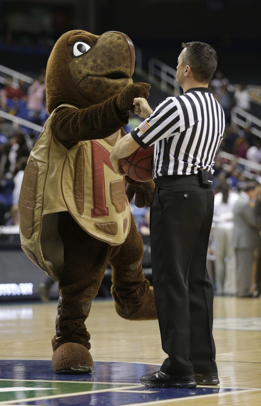 The Maryland mascot greets a referee during the first half of an NCAA college basketball game against North Carolina at the Atlantic Coast Conference tournament in Greensboro, N.C., Saturday, March 9, 2013. (AP Photo/Chuck Burton)