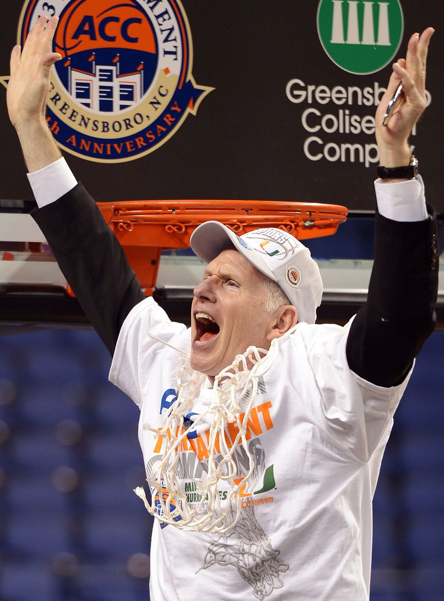 Miami head coach Jim Larranaga cheers after cutting the final strand of the net following their 87-77 win over North Carolina in an NCAA college basketball game for the championship in the Atlantic Coast Conference tournament in Greensboro, N.C., Sunday March 17, 2013. (AP Photo/The Times-News, Scott Muthersbaugh)