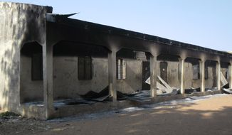 **FILE** A burnt-out school block in Potiskum, Nigeria, is seen here on Oct. 20, 2012, following a gun battle and explosions by the Boko Haram sect. (Associated Press)