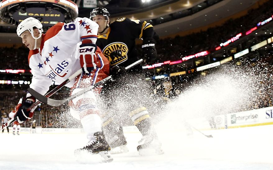 Washington Capitals defenseman Steven Oleksy defnds the front of the net during the third period of a NHL hockey game against the Boston Bruins in Boston Saturday, March 16, 2013. (AP Photo/Winslow Townson)