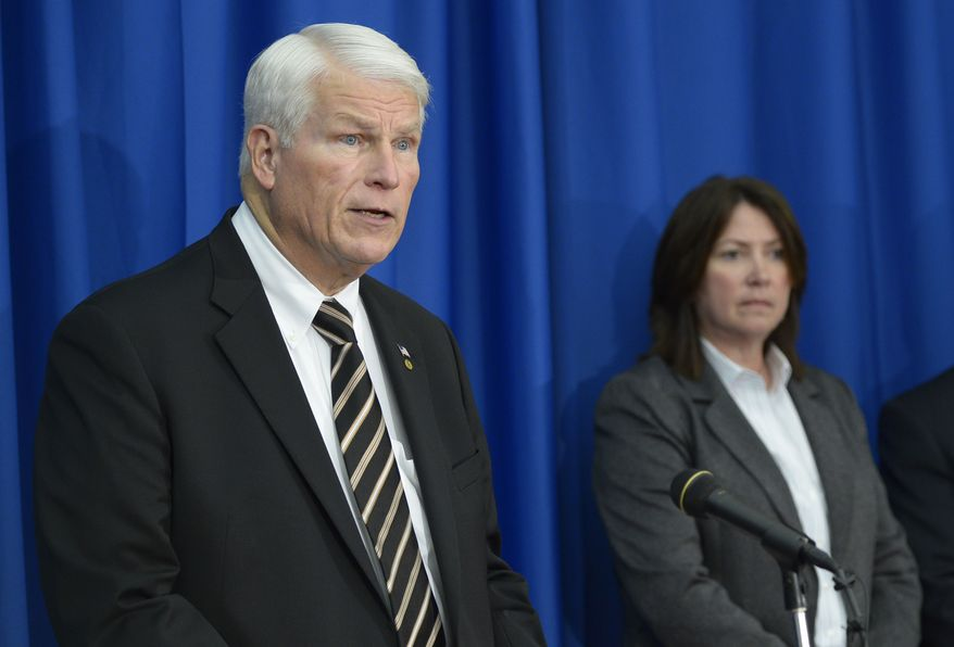 University of Central Florida president John Hitt (left) answers questions March 18, 2013, in Orlando, Fla., during a news conference after the apparent suicide of UCF student James Oliver Seevakumaran in his dorm room. Seevakumaran's body was found with an assault rifle and explosive devices. At right is ATF special agent Julie Torrez. (Associated Press)