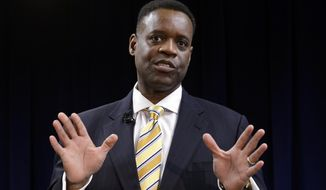 ** FILE ** Kevyn Orr answers a question during a news conference in Detroit on Thursday, March 14, 2013. (AP Photo/Paul Sancya)