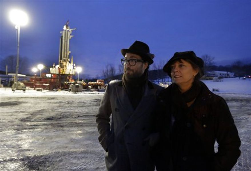 In this Jan. 17, 2013 photo, Sean Lennon and actress Susan Sarandon visit a fracking site in New Milford, Pa. Dozens of celebrities may be running afoul of the law as they unite under the banner of a group, Artists Against Fracking, that opposes hydraulic fracturing and boasts members including Yoko Ono and actors Mark Ruffalo and Susan Sarandon. (AP Photo/Richard Drew, File)