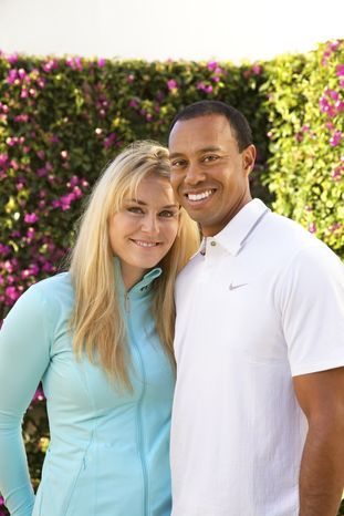 In this 2013 photo provided by Tiger Woods and Lindsey Vonn, golfer Tiger Woods and skier Lindsey Vonn pose for a portrait. Two months after rumors began circulating in Europe, Woods and Vonn posted separate items on their Facebook pages Monday, March 18, 2013, to announce their relationship. (AP Photo/Courtesy Tiger Woods/Lindsey Vonn)