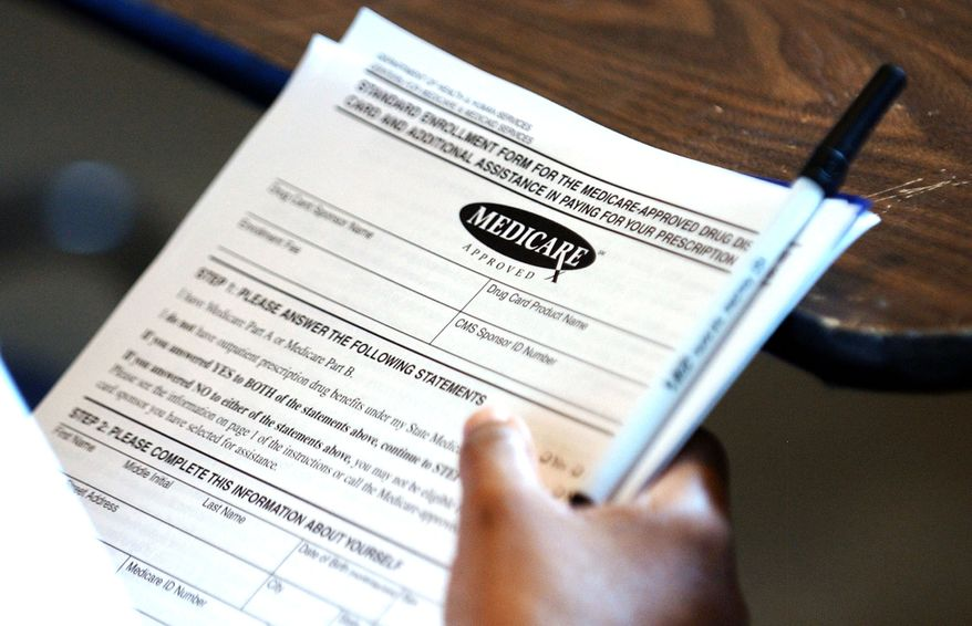 **FILE** A Yazoo City, Miss., resident holds copies of a Medicare-approved drug card application on July 27, 2004, in Yazoo City. (Associated Press)