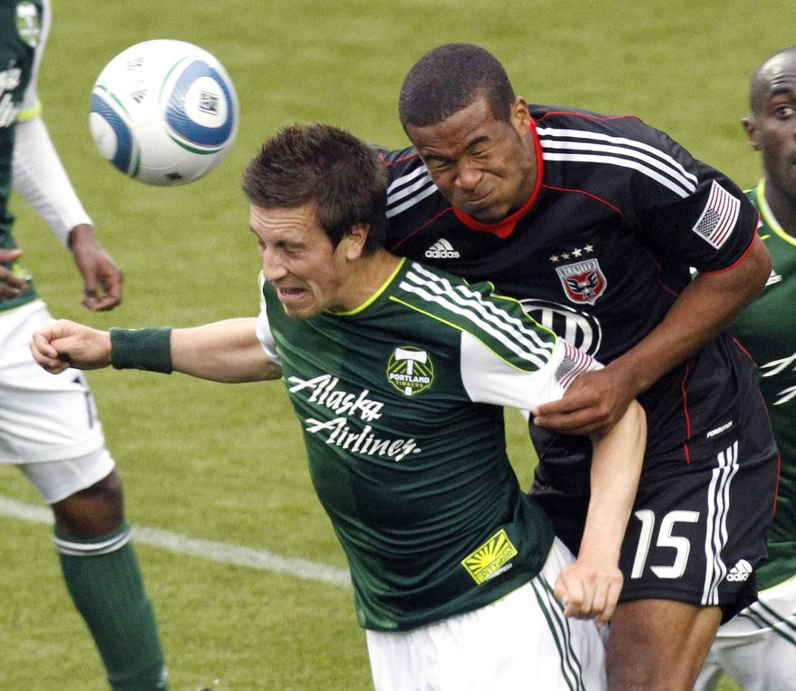 **FILE** Portland Timbers midfielder Ryan Pore, left, and DC United defender Ethan White fight for the ball during the second half of their MLS soccer game in Portland, Ore., Sunday, May, 29, 2011. DC United beat the Timbers 3-2. (AP Photo/Don Ryan)