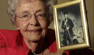 Juanita Tudor Lowrey, 86, holds a photo of her father, Civil War veteran Hugh Tudor, on Tuesday, March 19, 2013, in Kearney, Mo. Ms. Lowrey received pension benefits related to her father's Civil War service until she was 18 after her father died when she was 2 years old. (AP Photo/Charlie Riedel)