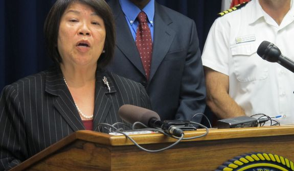 U.S. Attorney Florence Nakakuni announces at a news conference in Honolulu on Monday, March 18, 2013, that authorities have charged Benjamin Pierce Bishop, a U.S. Pacific Command defense contractor, with giving defense secrets to a Chinese woman with whom he was romantically involved. (AP Photo/Audrey McAvoy)