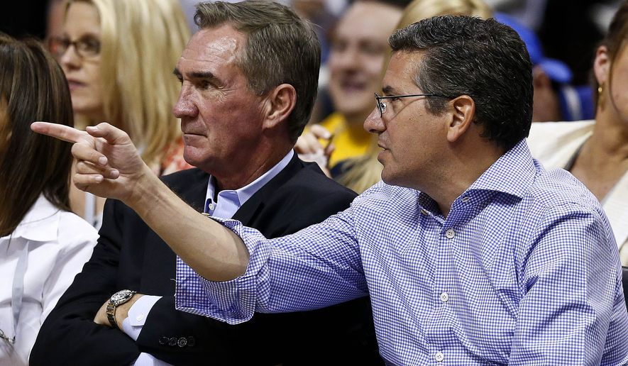 Washington Redskins owner Dan Snyder, right, watches a Phoenix Suns versus Los Angeles Lakers matchup with Redskins head coach Mike Shanahan in the second half of an NBA basketball game on Monday, March 18, 2013, in Phoenix. The Suns defeated the Lakers 99-76. (AP Photo/Ross D. Franklin)