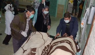 """**FILE** In this photo released by the Syrian official news agency SANA, victims who suffered an alleged chemical attack at Khan al-Assal village are covered by blankets as they receive treatment at a hospital in Aleppo on March 19, 2013. Syria's information minister says a chemical weapon fired by rebels on a village in the north of the country is the """"first act"""" by the opposition interim government announced in Istanbul. Rebels have denied the accusation and say regime forces fired the weapon. (Associated Press/SANA)"""