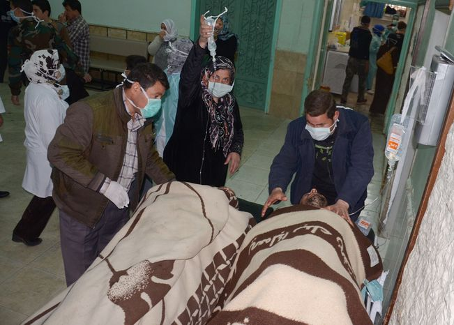 "**FILE** In this photo released by the Syrian official news agency SANA, victims who suffered an alleged chemical attack at Khan al-Assal village are covered by blankets as they receive treatment at a hospital in Aleppo on March 19, 2013. Syria's information minister says a chemical weapon fired by rebels on a village in the north of the country is the ""first act"" by the opposition interim government announced in Istanbul. Rebels have denied the accusation and say regime forces fired the weapon. (Associated Press/SANA)"