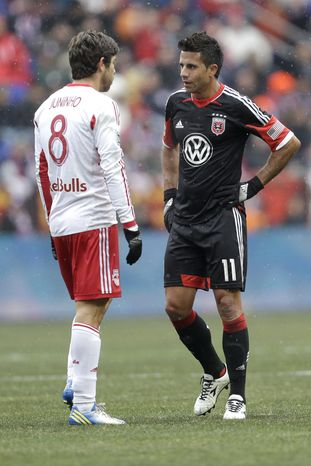 D.C. United midfielder Marcelo Saragosa, right, and New York Red Bulls midfielder Juninho exchange words during the second half of an MLS soccer game, Saturday, March 16, 2013, in Harrison, N.J. The teams tied 0-0. (AP Photo/Julio Cortez)