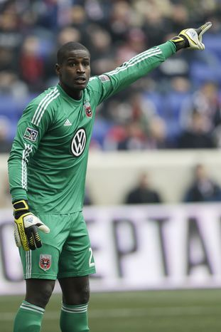 D.C. United goalkeeper Bill Hamid gestures during the first half of an MLS soccer game against the New York Red Bulls, Saturday, March 16, 2013, in Harrison, N.J. (AP Photo/Julio Cortez)