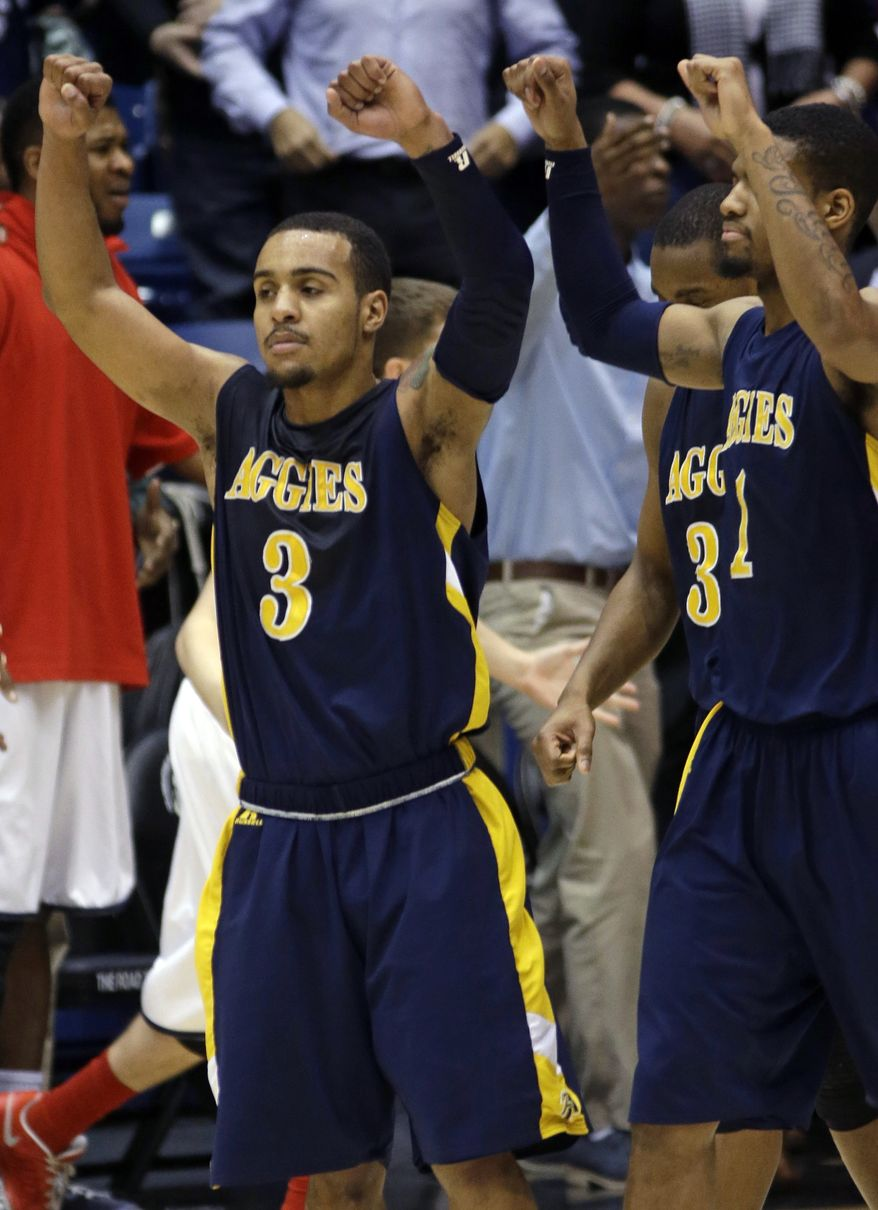 North Carolina A&T guard Jeremy Underwood (3) celebrates after they defeated Liberty 73-72 in a first round NCAA college basketball tournament game, Tuesday, March 19, 2013, in Dayton, Ohio. Underwood led North Carolina A&T with 19 points. (AP Photo/Al Behrman)