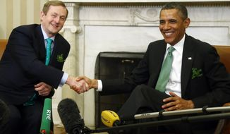 President Obama meets with Irish Prime Minister Enda Kenny in the Oval Office of the White House in Washington on Tuesday, March 19, 2013. (AP Photo/Charles Dharapak)
