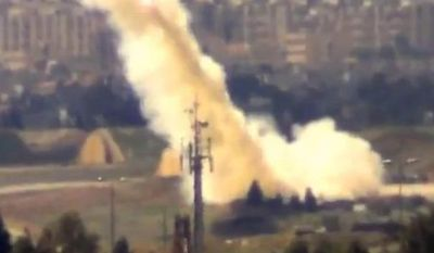 In this image taken from video obtained from the Shaam News Network, which has been authenticated based on its contents and other AP reporting, and released Monday March 18, 2013, Syrian government forces fire rockets toward residential neighborhoods, in Damascus, Syria. (AP Photo/Shaam News Network via AP video)