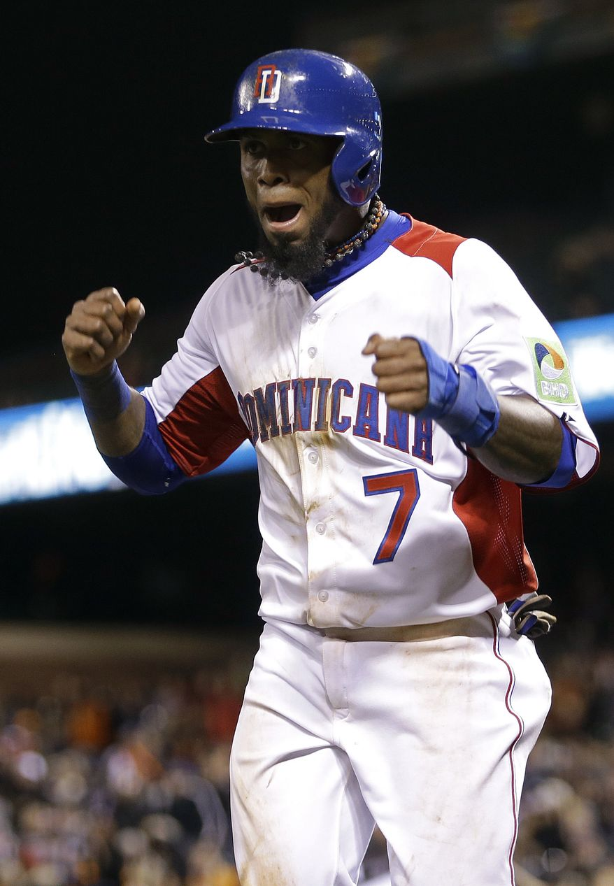 Dominican Republic's Jose Reyes (7) celebrates after scoring against the Netherlands during the fifth inning of a semifinal game of the World Baseball Classic in San Francisco, Monday, March 18, 2013. (AP Photo/Ben Margot)
