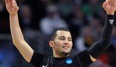 Virginia Commonwealth guard Joey Rodriguez gestures after a three-pointer in a third-round NCAA tournament college basketball game against Purdue in Chicago on Sunday. (Associated Press)