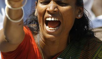 associated press An Indian Tamil activist shouts slogans Wednesday in Mumbai during a protest against Sri Lanka's alleged wartime abuses. A key ethnic Tamil party withdrew from India's coalition government Tuesday, and it has demanded that the U.N. Human Rights Council resolution accuse Sri Lanka of genocide against the minority Tamil population.