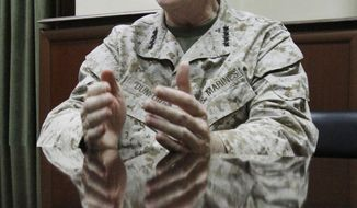 U.S. Marine Corps Gen. Joseph F. Dunford Jr., the top American and NATO commander in Afghanistan, gestures during an interview with the Associated Press at his headquarters in Kabul, Afghanistan, on Monday, March 18, 2013. (AP Photo/Ahmad Jamshid)