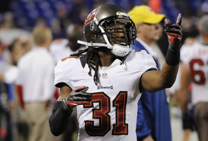 **FILE** Tampa Bay Buccaneers cornerback E.J. Biggers (31) enjoys the moment during the second half of an NFL football game as the Buccaneers went on to beat the Minnesota Vikings Thursday, Oct. 25, 2012, in Minneapolis. (AP Photo/Jim Mone)