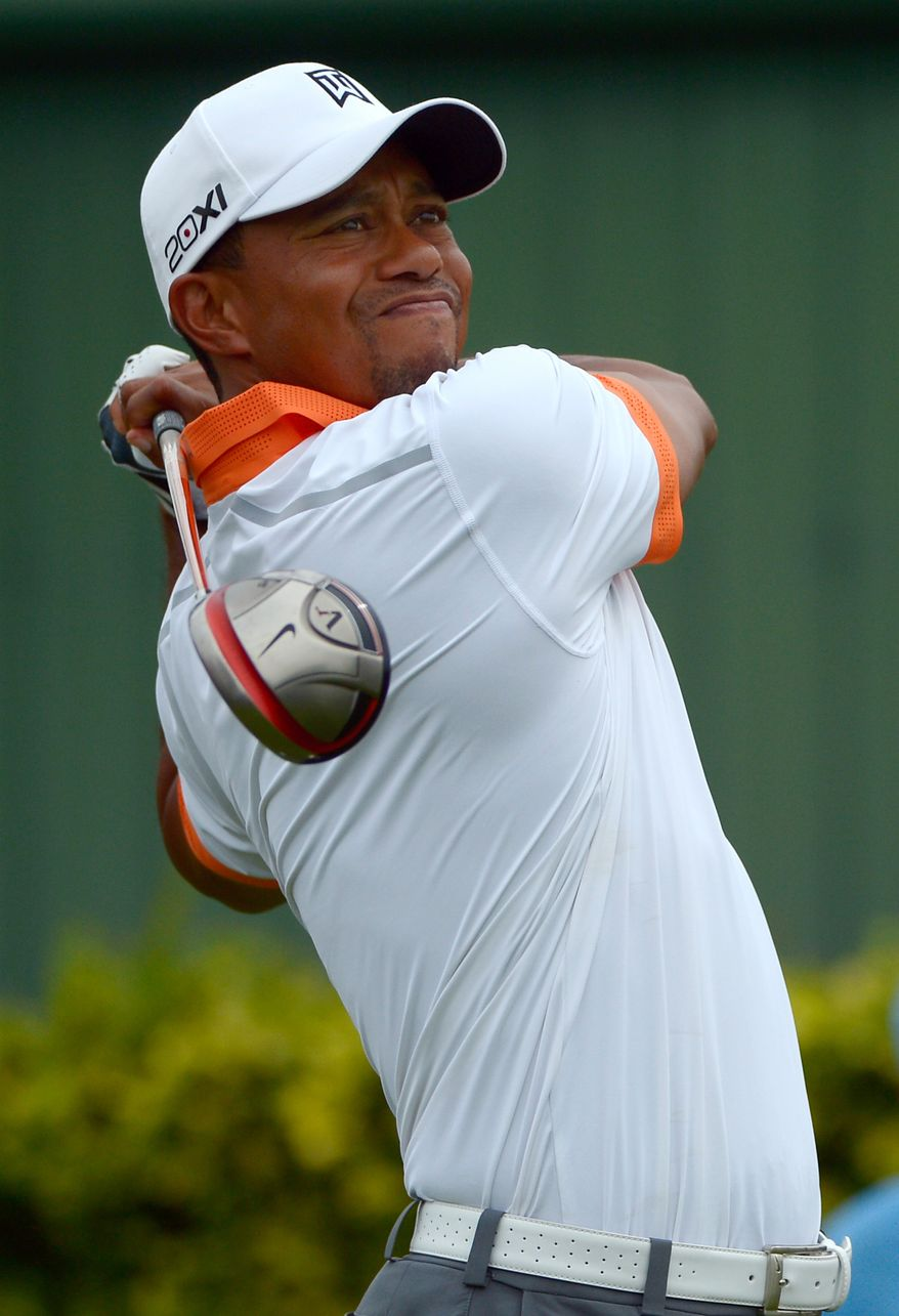 Tiger Woods watches his tee shot on the ninth hole during the pro-am of the Arnold Palmer Invitational golf tournament in Orlando, Fla., Wednesday, March 20, 2013.(AP Photo/Phelan M. Ebenhack)