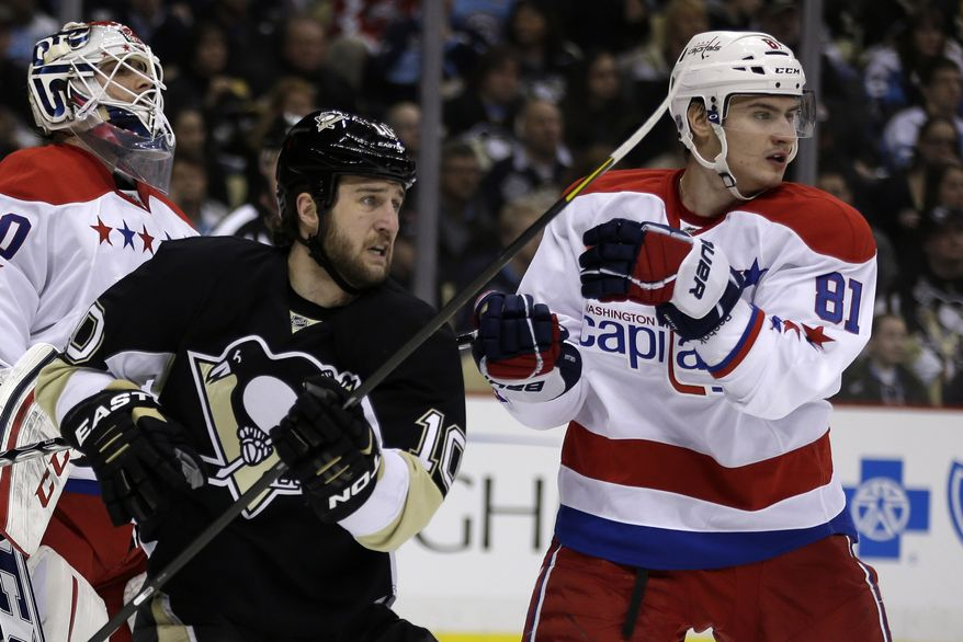 Washington Capitals defenseman Dmitry Orlov (81) battles Pittsburgh Penguins center Tanner Glass (10) during the second period of an NHL hockey game against the Pittsburgh Penguins in Pittsburgh Tuesday, March 19, 2013. The Penguins won 2-1. (AP Photo/Gene J. Puskar)