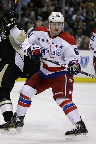 Washington Capitals defenseman Dmitry Orlov (81) skates during the second period of an NHL hockey game against the Pittsburgh Penguins in Pittsburgh Tuesday, March 19, 2013. The Penguins won 2-1. (AP Photo/Gene J. Puskar)