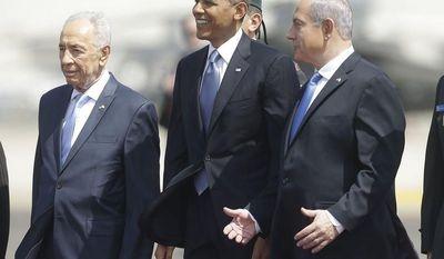 President Barack Obama is greeted by Israeli President Shimon Perez, left, and Israeli Prime Minister Benjamin Netanyahu upon his arrival ceremony at Ben Gurion International Airport in Tel Aviv, Israel, Wednesday, March 20, 2013, (AP Photo/Pablo Martinez Monsivais)