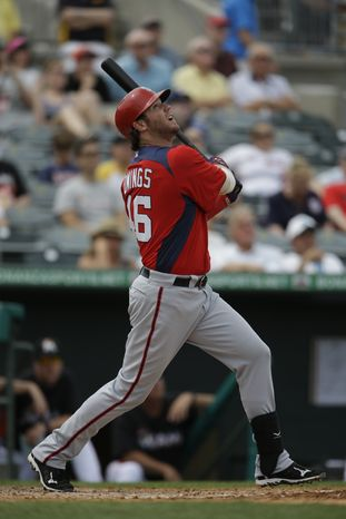 Washington Nationals' Micah Owings bats during the seventh inning of an exhibition spring training baseball game against the Miami Marlins Wednesday, March 20, 2013, in Jupiter, Fla. (AP Photo/Jeff Roberson)