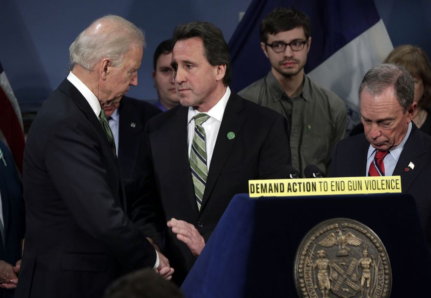Vice President Joseph R. Biden shakes hands with Neil Heslin (center), whose son Jesse Lewis died at the school shootings in Newtown, Conn., after Biden spoke in New York's City Hall Blue Room on March 21, 2013. Relatives of shooting victims from Newtown, Conn., stood with New York Mayor Michael Bloomberg (right) and Biden as they spoke in favor of an assault weapons ban. (Associated Press)