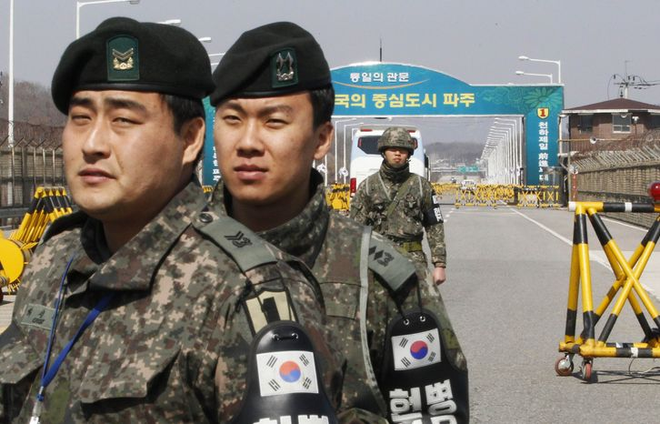 South Korean Army soldiers stand guard at the Unification Bridge near the border village of Panmunjom in Paju, South Korea, Thursday, March 21, 2013. North Korea has threatened revenge for the sanctions and for ongoing U.S.-South Korean military drills, which the allies describe as routine but which Pyongyang says are rehearsals for invasion. (AP Photo/Ahn Young-joon)
