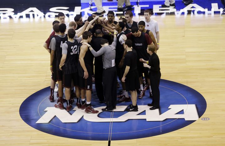 The Harvard team huddles following practice for a second-round game of the NCAA college basketball tournament, Wednesday, March 20, 2013, in Salt Lake City. Harvard is scheduled to play New Mexico Thursday. (AP Photo/Rick Bowmer)