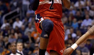 Washington Wizards' John Wall scores against the Phoenix Suns during the first half of an NBA basketball game on Wednesday, March 20, 2013, in Phoenix. (AP Photo/Matt York)