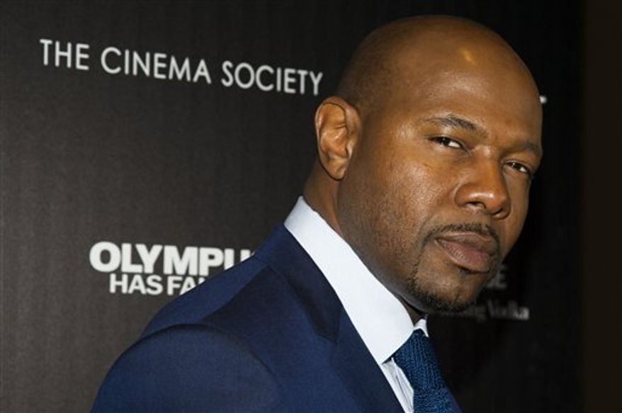 "Director Antoine Fuqua attends a screening of FilmDistrict's ""Olympus Has Fallen"" on Monday, March 11, 2013 in New York. (Photo by Charles Sykes/Invision/AP)"