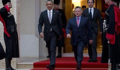 President Barack Obama walks with Jordan's King Abdullah II to participate in an official arrival ceremony at the Al-Hummar Palace, the residence of Jordanian King Abdullah II, Friday, March 22, 2013, in Amman, Jordan. (AP Photo/Carolyn Kaster)