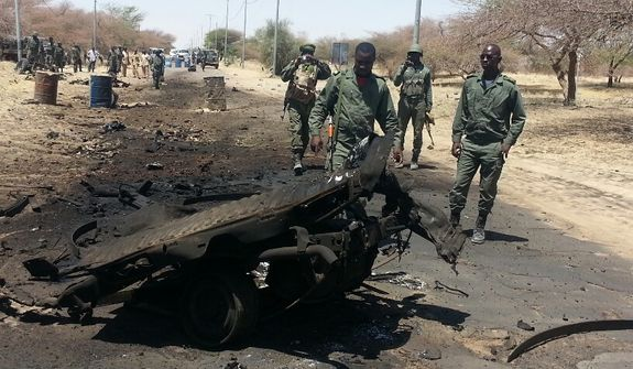 March 21: The scene is about 5 miles from Timbuktu. A suicide car bomber hit a checkpoint, injuring seven Malian soldiers. One other soldier was injured by friendly fire from French troops and died in hospital. Five insurgents were killed and one captured. An unknown number of insurgents escaped. (Photo by Yeah Samake)