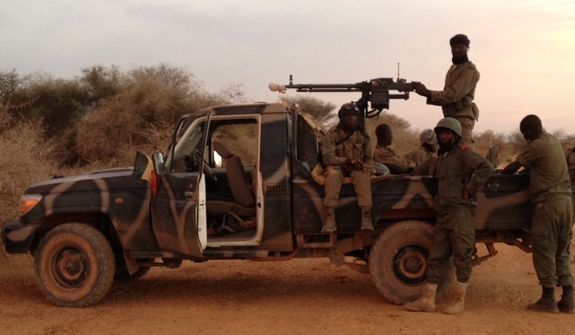March 19: Just arrived in Timbuktu after 20 hours of grueling roads. We had four military vehicles with 20 soldiers. (Photo by John Price)